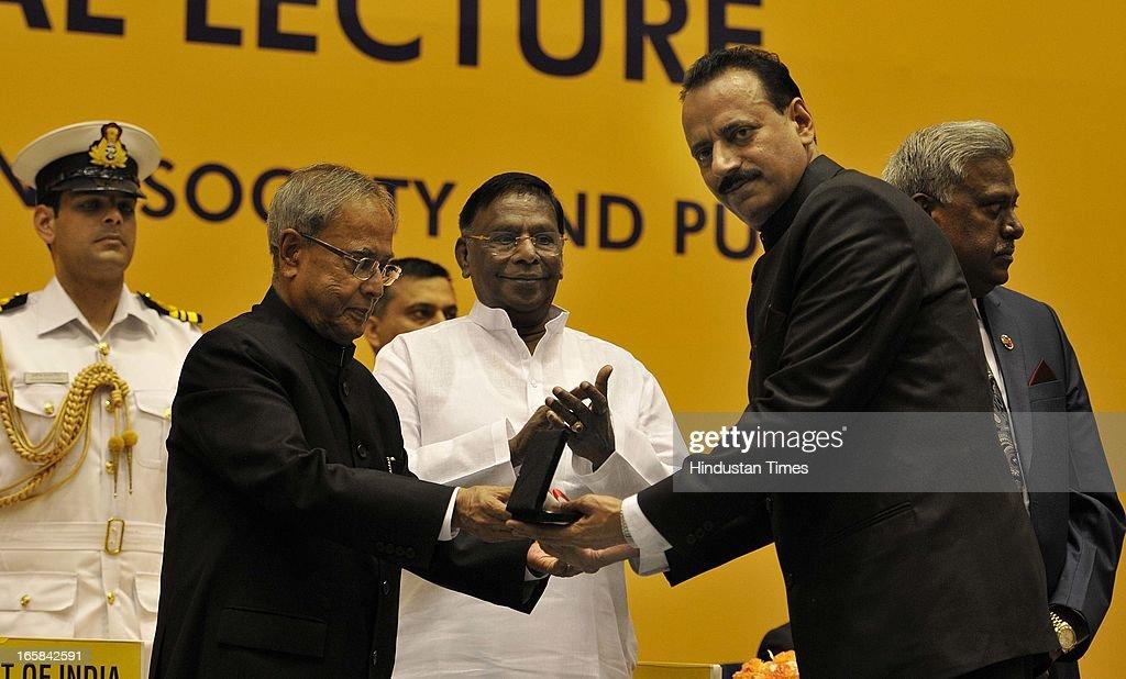 President Pranab Mukherjee presents Police Medal 2012 to Inspector R K Gaur as MoS at PMO V Narayanasamy and CBI Director Ranjit Sinha look during the Golden Jubilee celebration of CBI on April 6, 2013 in New Delhi, India.