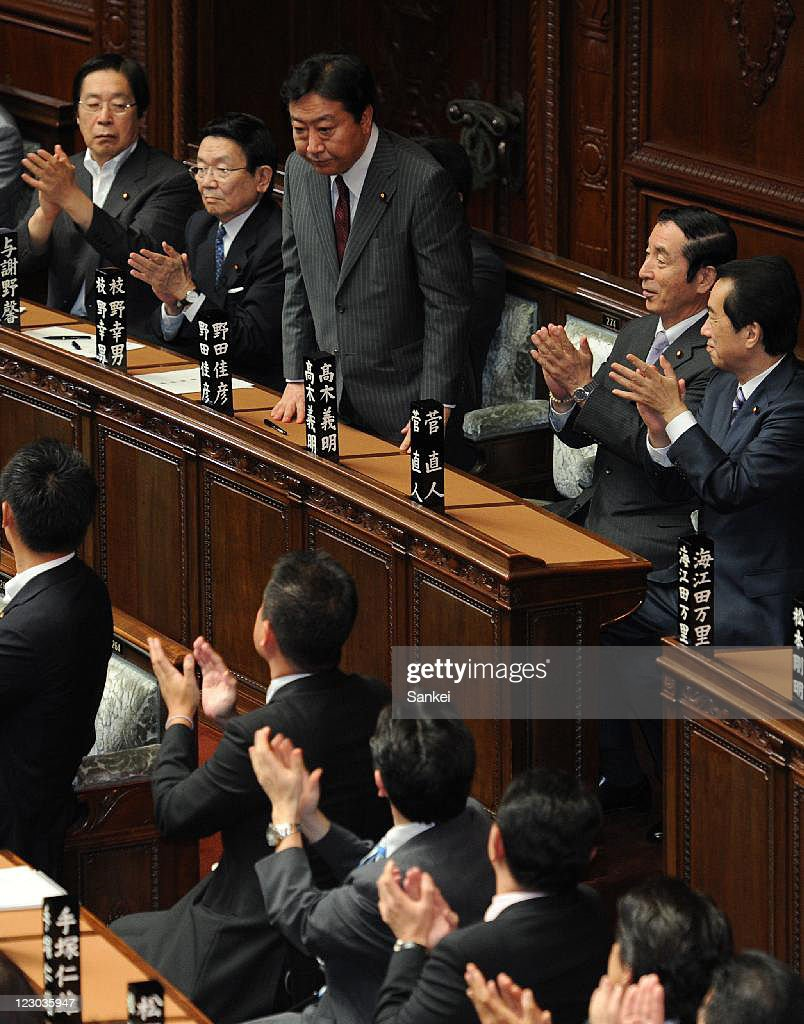 New Democratic Party of Japan (DPJ) President Yoshihiko Noda (3L, top) is applauded by fellow lawmakers after being elected Japan's 95th Prime Minister at the lower house on August 30, 2011 in Tokyo, Japan. Noda become the sixth Prime Minister in five years.