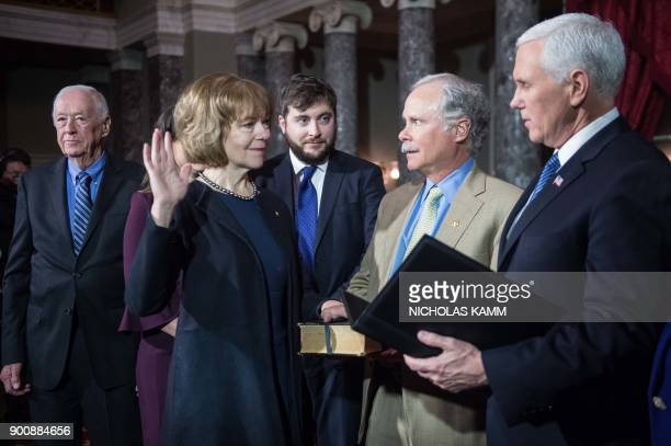 New Democratic US Senator from Minnesota Tina Smith is ceremonially sworn in by Vice President Mike Pence at the Capitol in Washington DC on January...