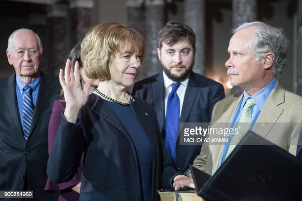 New Democratic US Senator from Minnesota Tina Smith is ceremonially sworn in as her father F Harlan Flint son Sam Smith and husband Archie Smith look...