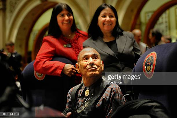 New Denver democratic Senator Irene Aguilar and her sister Fran Walendzik pose behind their father Frank Aguilar before the start of the Colorado...
