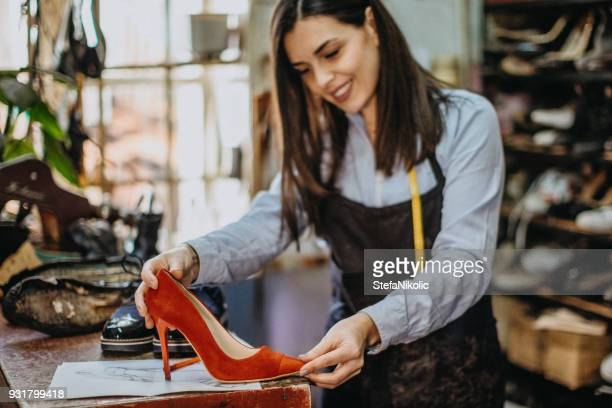 new design for red shoes - shoemaker stock photos and pictures