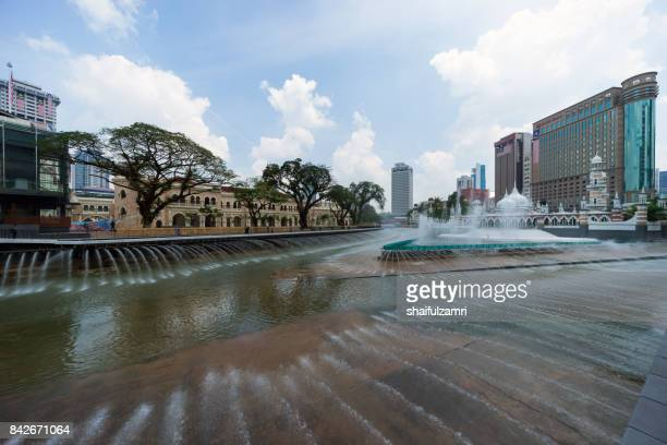 new development taking place at masjid jamek kuala lumpur as part of river of life project by city council of kuala lumpur. - shaifulzamri stock pictures, royalty-free photos & images