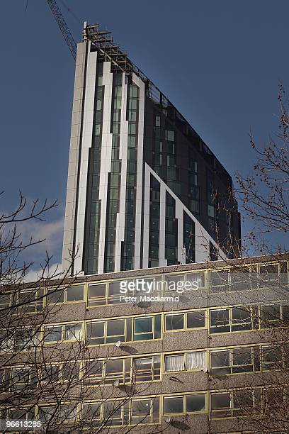 A new development towers over empty flats on the Heygate housing estate near Elephant and Castle on February 11 2010 in London England The Heygate...