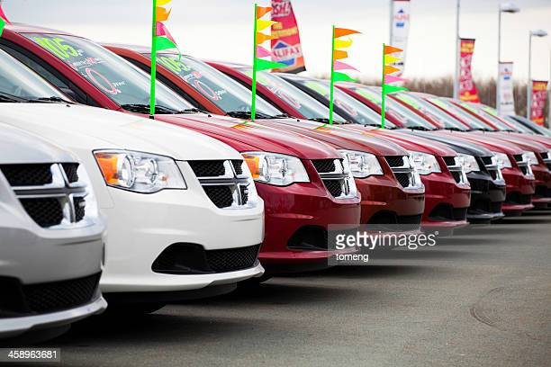 New Dodge Caravans in a Row at Car Dealership