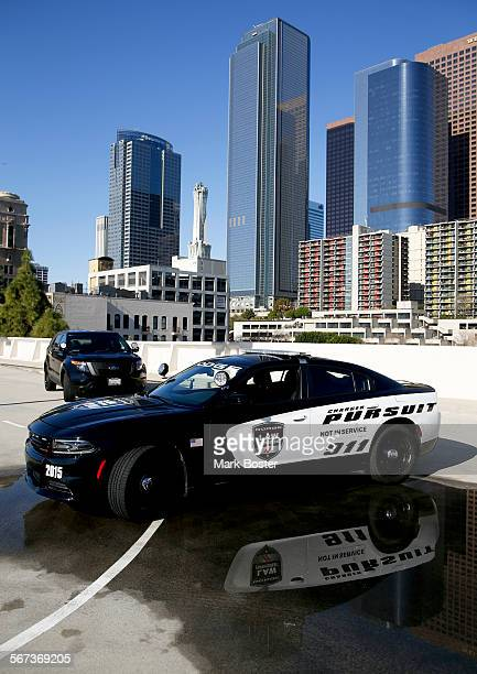 New Dodge Charger and Ford Explorer police cars on the roof of the Los Angeles Times garage March 4 2015
