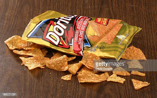 New Doritos to be shot in the studio review Rather than a pristine shot of the bag I'd like it crumple and some crunched Doritos spread around Like...