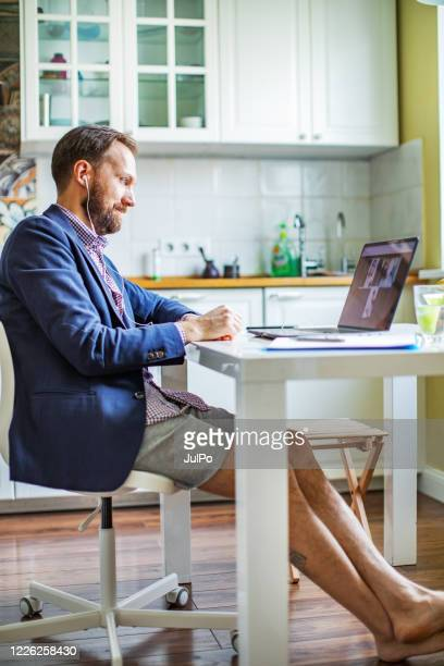 new dress code for online business meetings during quarantine - shorts stock pictures, royalty-free photos & images