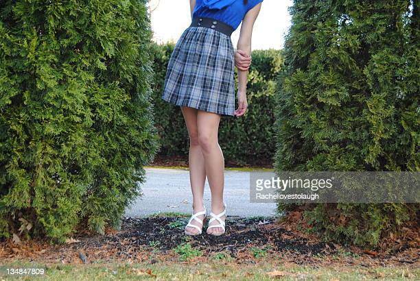 new dress - girls in plaid skirts stock photos and pictures