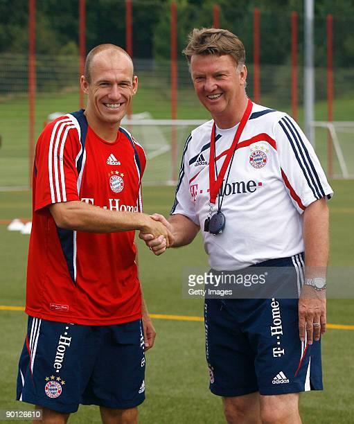 New Dutch forward Arjen Robben of FC Bayern Muenchen and FC Bayern Muenchen head coach Louis van Gaal shake hands during the Bayern Muenchen training...
