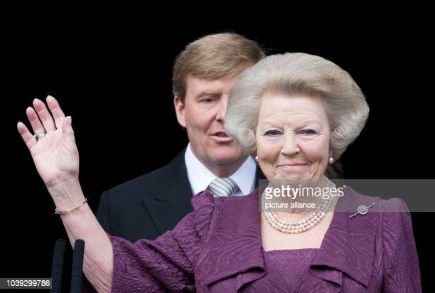 New Dutch King Willem-Alexander and Royal Highness Princess Beatrix are seen on the balcony of the Royal Palace at the Dam Square in Amsterdam, The...