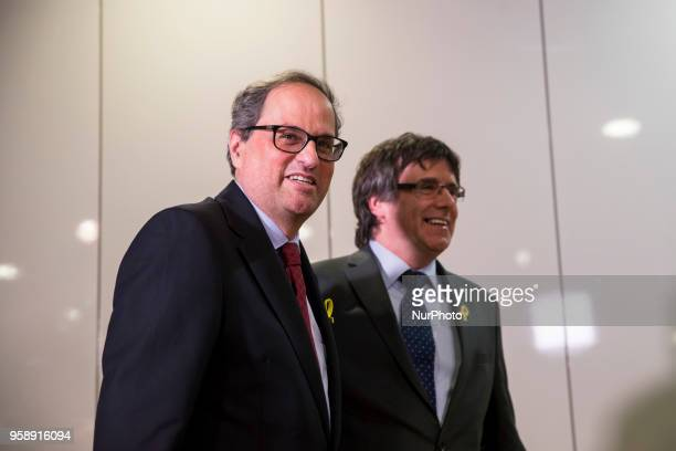 New elected and former Catalan Prime Minister Qim Torra and Carles Puigdemont hold a press conference in Berlin Germany on May 15 2018