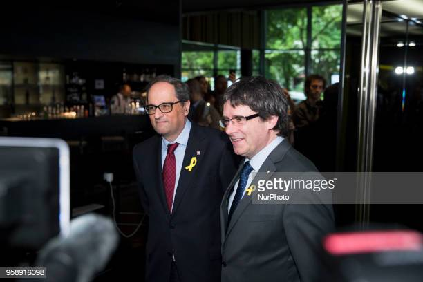 New elected and former Catalan Prime Minister Qim Torra and Carles Puigdemont arrive to hold a press conference in Berlin Germany on May 15 2018
