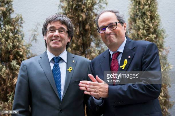 New elected and former Catalan Prime Minister Qim Torra and Carles Puigdemont chat prior to a press conference in Berlin Germany on May 15 2018