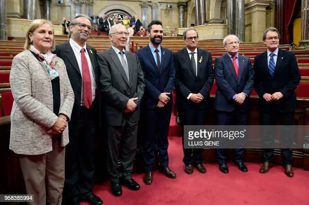 New elected Catalan regional president Quim Torra poses with current Catalan Parliament Speaker Roger Torrent and former presidents of the Catalan...
