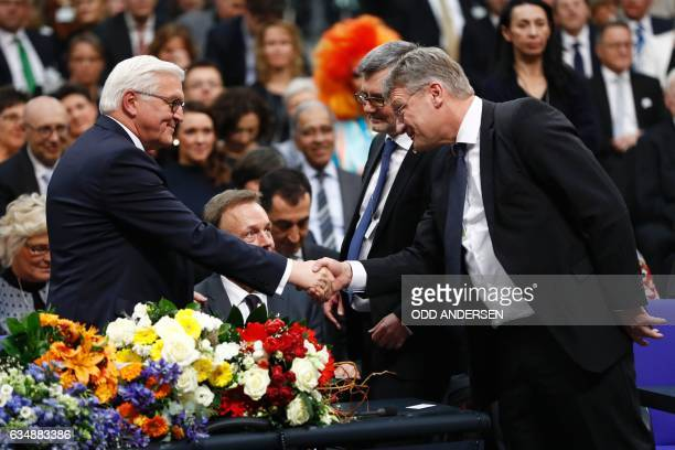 New elected German President FrankWalter Steinmeier is congratulated by leading member of the AFD party Joerg Meuthen after the presidential election...