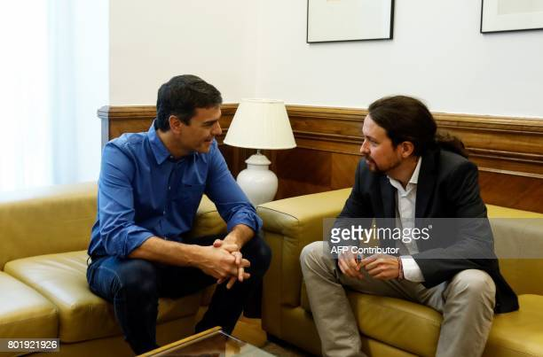 New elected leader of Spanish Socialist Party Pedro Sanchez and leader of left wing party Podemos Pablo Iglesias chat before a meeting at the...