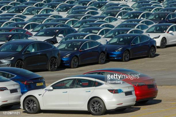 New electric automobiles, manufactured by Tesla Inc., sit on the dockside after being imported to the Port of Southampton in Southampton, U.K., on...