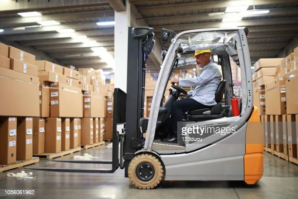 new electric forklift - forklift stock pictures, royalty-free photos & images