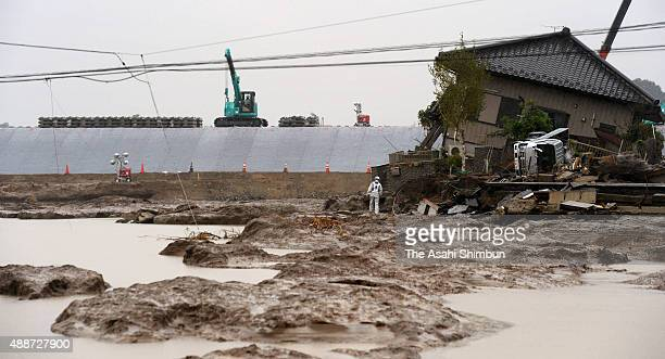 New embankment construction continues after collapse caused flooding on September 17 2015 in Joso Ibaraki Japan Torrential rain in Ibaraki Tochigi...