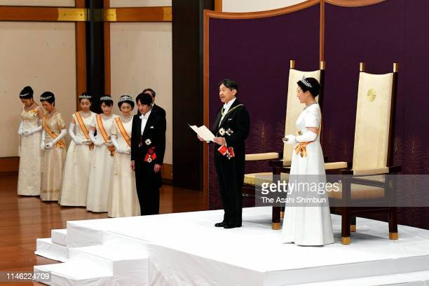 New Emperor Naruhito addresses while Empress Masako Crown Prince Akishino Crown Princess Kiko of Akishino Princess Mako of Akishino Princess Kako of...