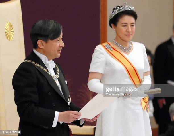New Emperor Naruhito addresses while Empress Masako listens during the 'SokuigoChokennoGi' ceremony that Naruhito receives representatives of the...