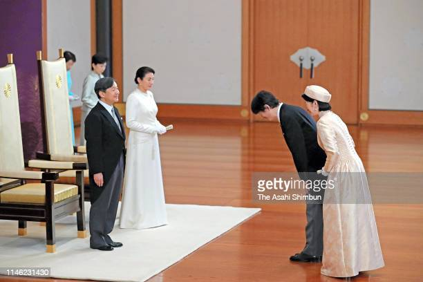New Emperor Naruhito and Empress Masako are greeted by Crown Prince Akishino and Crown Princess Kiko of Akishino during the ceremony to celebrate his...