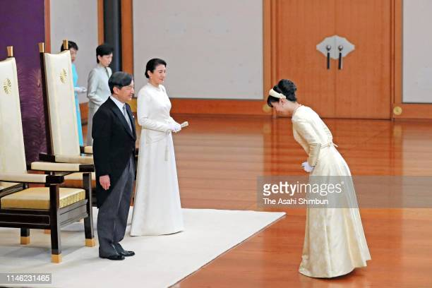 New Emperor Naruhito and Empress Masako are greeted by Princess Kako of Akishino during the ceremony to celebrate his accession to the Chrysanthemum...