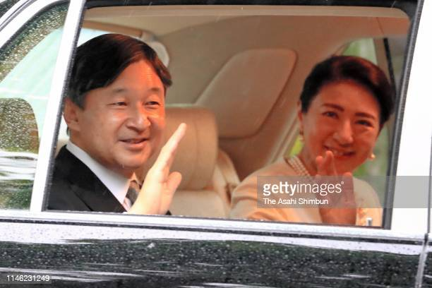 New Emperor Naruhito and Empress Masako wave to well-wishers on arrival at the Akasaka Palace after attending ceremonies on May 1, 2019 in Tokyo,...