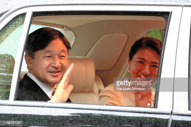 New Emperor Naruhito and Empress Masako wave to wellwishers on arrival at the Akasaka Palace after attending ceremonies on May 1 2019 in Tokyo Japan...