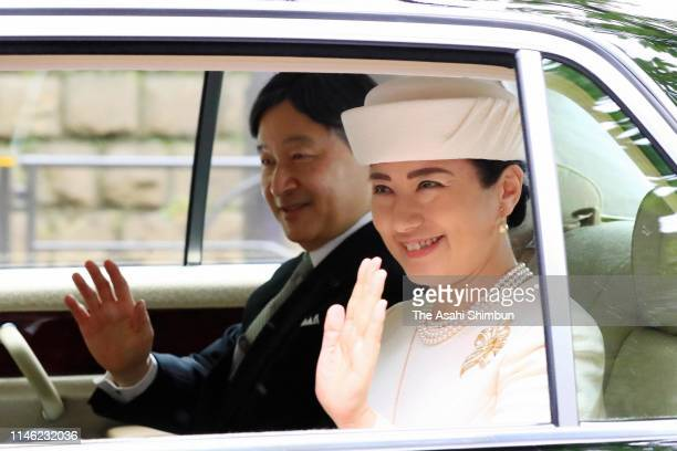 New Emperor Naruhito and Empress Masako wave to well-wishers on departure for the Imperial Palace to meet Emperor Emeritus Akihito and Empress...