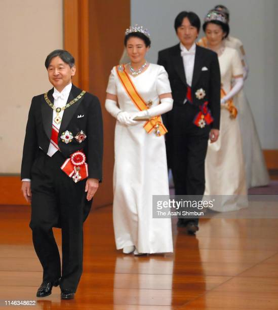 New Emperor Naruhito, Empress Masako, Crown Prince Akishino and Crown Princess Kiko of Akishino enter the Matsu-no-Ma hall to attend the...