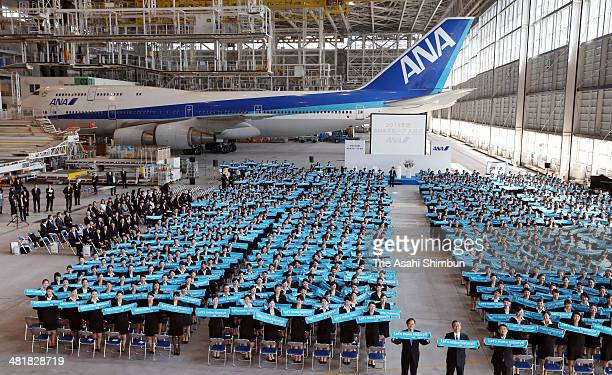 New employees of All Nippon Airways Co attend a welcoming ceremony at the ANA's hangar on April 1 2014 in Tokyo Japan Japan's new fiscal and school...