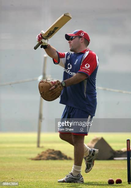 New England Assistant coach and team analyst Mark Garaway swings a bat during the England nets session at the Brabourne Cricket ground on February...