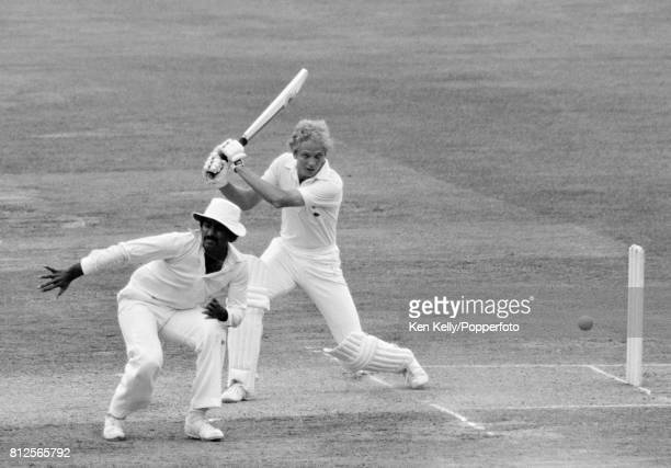 New England captain David Gower drives past Pakistan fielder Javed Miandad during his innings of 29 in the 2nd Test match between England and...