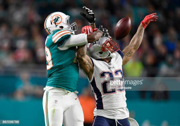 New England defensive back Patrick Chung breaks up a pass intended for Miami Dolphins tight end Julius Thomas during an NFL football game between the...