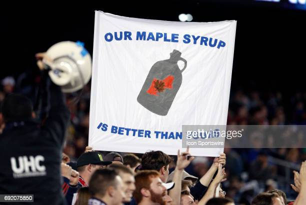 New England fans taunt Canadian maple syrup during a regular season MLS match between the New England Revolution and Toronto FC on June 3 at Gillette...