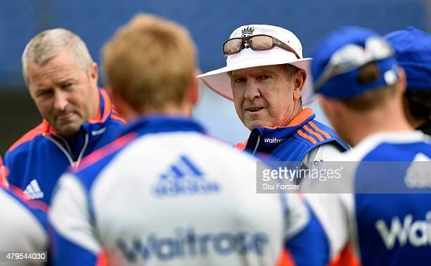 New England head coach Trevor Bayliss speaks to his players as assistant Paul Farbrace looks on during England net practice at the Swalec stadium on...
