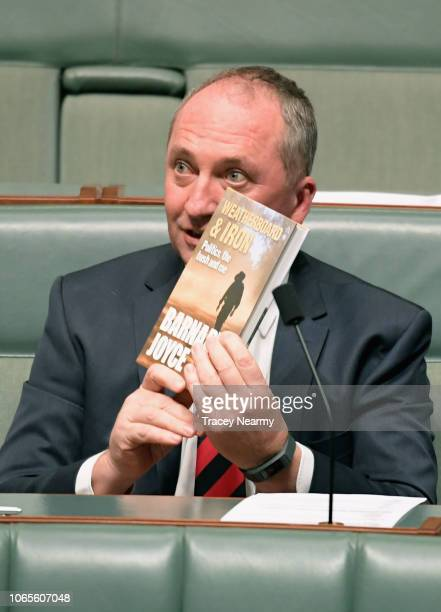 New England MP Barnaby Joyce holds up his book Weatherboard and Iron during question time at Parliament House on November 27, 2018 in Canberra,...