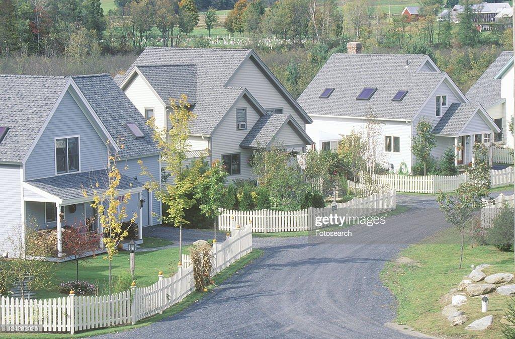 New England neighborhood with white picket fences : Stock Photo