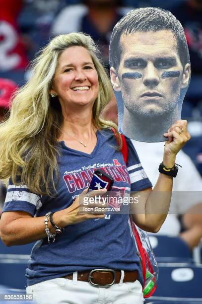 New England Patriot fan holds her Tom Brady cutout during the NFL preseason game between the New England Patriots and the Houston Texans on August 19...
