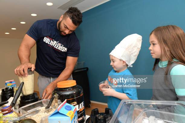 New England Patriot Kyle Van Noy makes smoothies with Daniel and Parker at Boston Children's Hospital on May 16 2018 in Boston Massachusetts