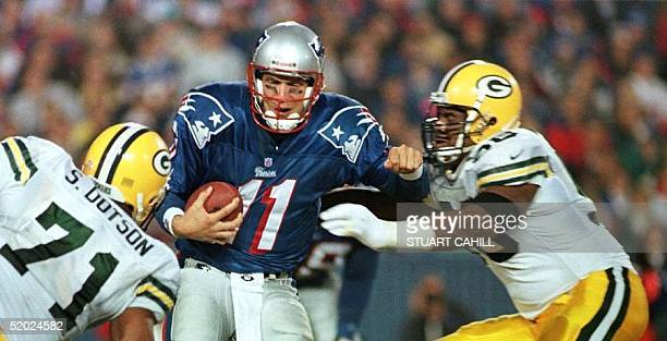 New England Patriot quarterback Drew Bledsoe is sacked by Green Bay Packer Gabe Wilkins and Santana Dotson during second quarter action at Foxboro...