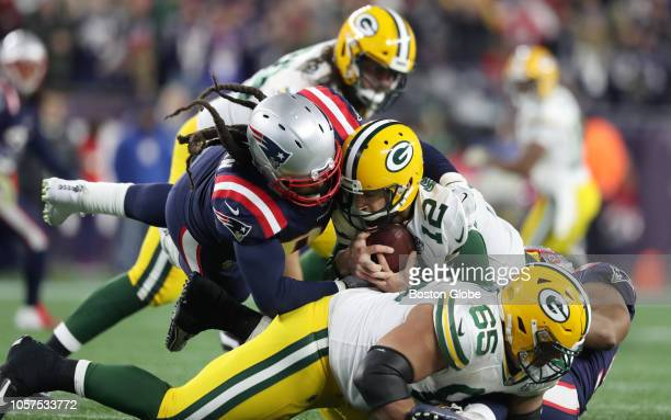 New England Patriots' Adrian Clayborn sacks Packers quarterback Aaron Rodgers during the fourth quarter. The New England Patriots host the Green Bay...