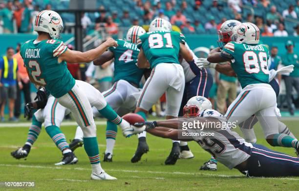 New England Patriots' Albert McClellan blocks a second quarter punt attempt by the Dolphins' Matt Haack. The New England Patriots visit the Miami...