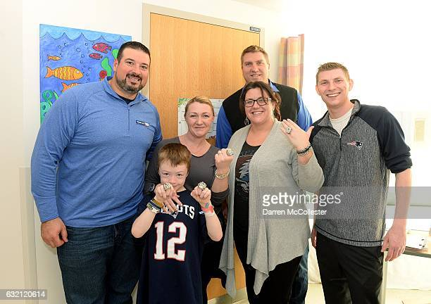 New England Patriots alumni Joe Andruzzi and Max Lane and magician John Logan visit with Devlin at Boston Children's Hospital on January 19 2017 in...