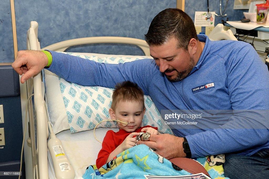 New England Patriots alumnus Joe Andruzzi visits with Jase at Boston Children's Hospital on January 19, 2017 in Boston, Massachusetts.