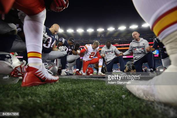 New England Patriots and Kansas City Chiefs players pray after the Chiefs defeated the Patriots 4227 at Gillette Stadium on September 7 2017 in...