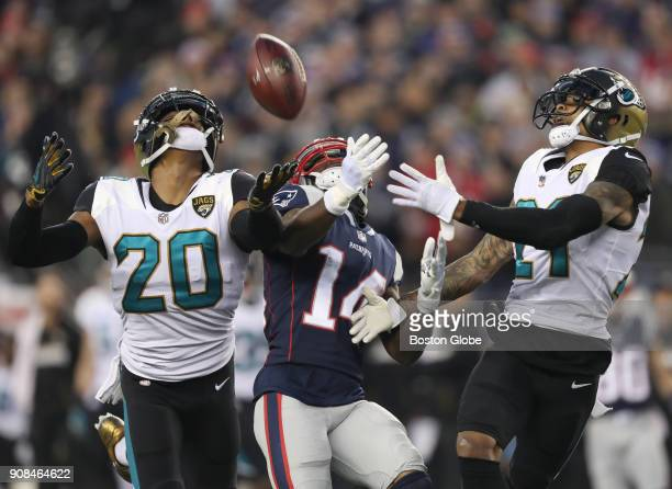 New England Patriots' Brandin Cooks can't come up with the catch defended by Jaguars' Jalen Ramsey left and AJ Bouye during the third quarter The New...