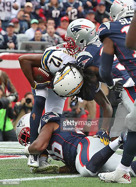 New England Patriots Brandon King and Jonathan Jones team up to tackle Los Angeles Chargers Travis Benjamin for a saftey during second quarter action...